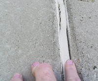 Sealant Failure - warehouse wall, loss of adhesion, failure, common